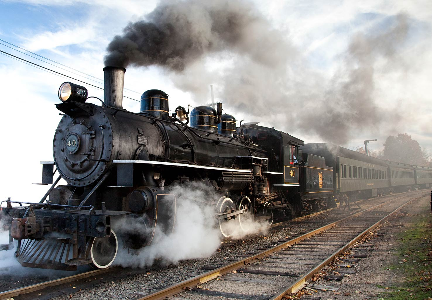 Steam train billowing smoke