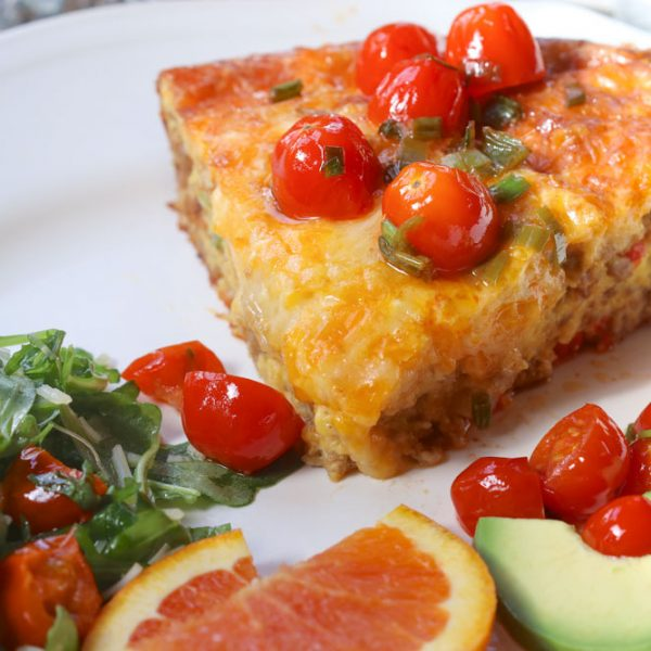 Frittata, avocado, mixed greens, garnished with cherry tomatoes and served with orange slices