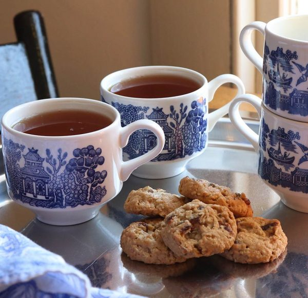 Two cups of tea and cookies on a platter