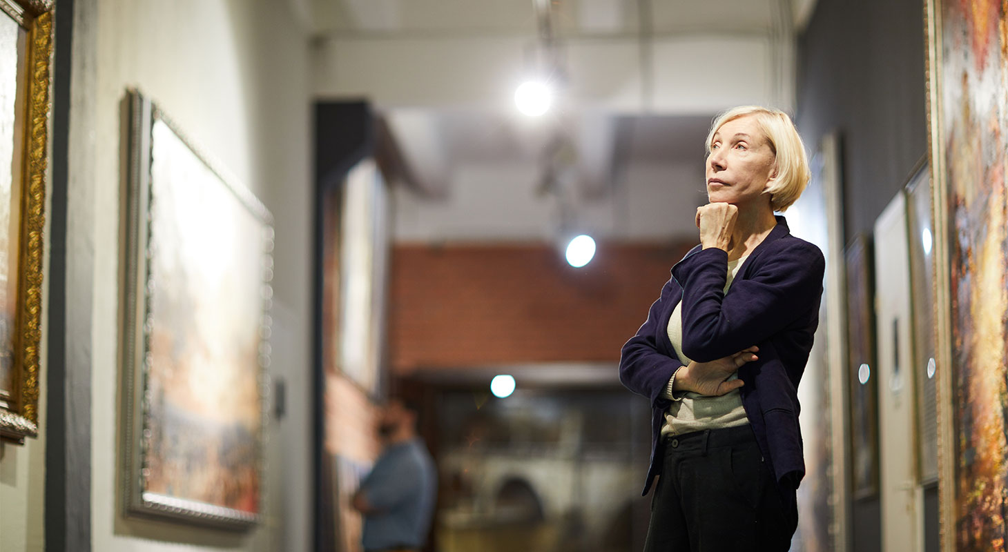 A woman admiring art in a museum