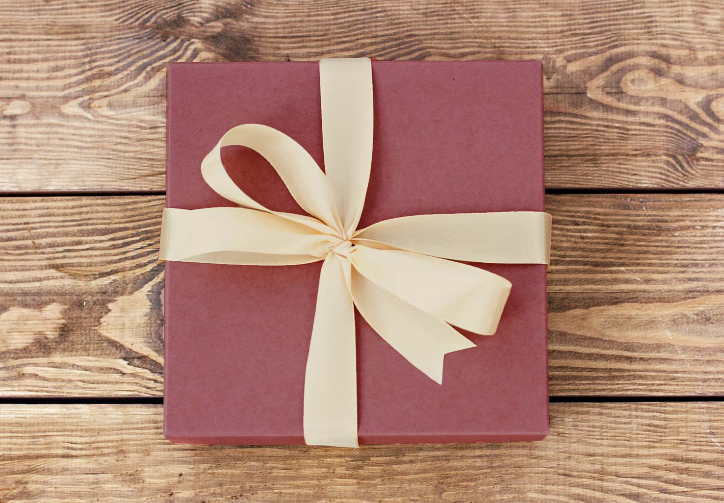 Maroon gift box with gold ribbon