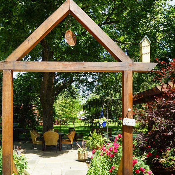 Wooden gateway leading to garden patio